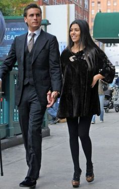 Kourtney Kardashian and Scott Disick go for a stroll after having lunch in Tribeca, with the always stylish Disick carrying a walking-stick. (October 23, 2010 - Photo by Bauer Griffin)