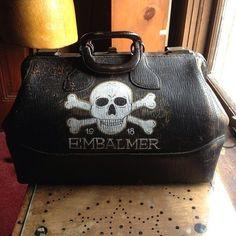 Skull and crossbones embalmer's bag. Maybe stencil graphics on a shaving kit travel bag?