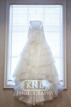 Sherie's beautiful wedding dress against the window. #weddingdress
