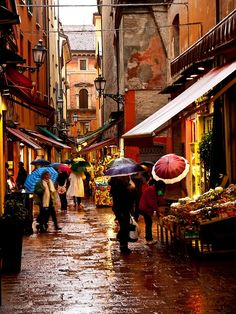In the quadrilateral area in Bologna, Italy on a rainy morning.