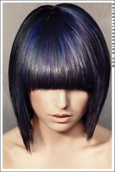 Hair Style: This is a fashionable hairstyle that is classy and sexy. The hair is straight and styled down past the chin level. A thick fringe is styled across on the forehead.  Hair Cut: The hair is cut short to medium length.  Hair Colour: The hair colouring is back with blue and purple highlights.