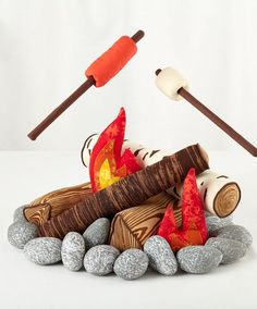 Shop The S'more the Merrier Campfire Set. There's nothing quite like huddling around a roaring plush campfire when you're roughing it in the rugged living room terrain.