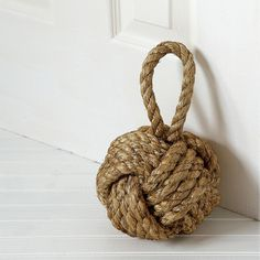 For pesky doors who insist on closing, this neutral and rustic knot door stopper will hold its own next to even the heaviest doors.