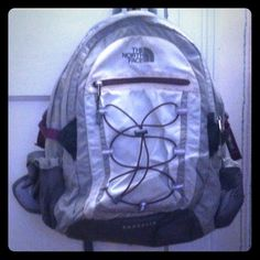 North Face Backpack Gray and purple north face backpack. Great for school! Comfortable fits heavy textbooks. Includes water bottle holders, front pocket for phone, interior zipper pocket with slots for pens and accessories, bigger pocket for books and laptop holder. No trades, firm price. North Face Bags Backpacks