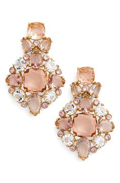 Blushing pink crystals and sparkling white bezels combine to make these Kate Spade earrings simply stunning.