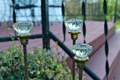 Glass doorknobs as decorations in the garden.