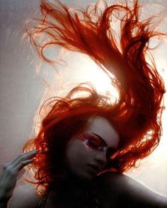 If one were to believe photography literally, us redheads' hair just flows upwards from our scalps like living flame...or in quiet moments (when we're standing pensively in that field, or naked in that lake, it swirls around like serpents of dark serenity. If you're lucky.