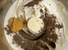 "Banana ""ice cream"" 3-4 bananas, sliced and frozen (slice before freezing) A spoonful of peanut butter 2-3 tsp. cocoa powder"