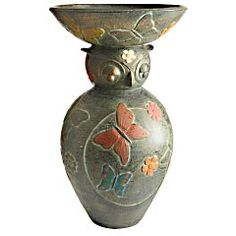 Terracotta Owl Birdbath    Clearance $64.98 Orig. $79.95  A sculpture and a functional birdbath? Hello, perfect garden combo. This springy owl is covered in butterflies and flowers and is ready to make some birds very happy. Instead of, you know, eating them like most owls.