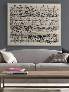 Personalized DIY Wall Art Ideas--Sheet Music   The space above a couch can be a challenge to fill. Large art can often cost an arm and a leg, so why not channel your inner Mozart and decorate with musical notes