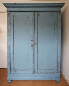 A mid 19th century, antique painted pine double wardrobe. This antique wardrobe has two panelled doors, complete with the original escuteons and locking key.