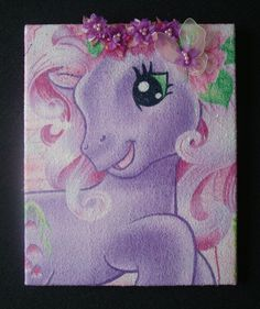 Upcycled 'My Little Pony' Wall Hanging - Made using a towel that my daughter was given. It was a really thin towel that didnt really dry at all & left fluff on everything. I was going to throw it out, then I decided to turn it into a wall hanging instead for my daughters birthday :-) Its stretched over an old canvas & I sewed on the flower tiara, butterfly & beeding etc. which were all bits out of my scrap box :-D