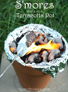 If you're going to camp in the backyard, you have to have s'mores. No need for a fire pit. A terracotta pot is all you need. Yum!