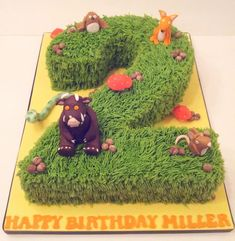 Chocolate sponge Birthday cake with buttercream piped grass and edible Gruffalo…