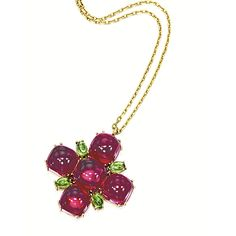 RUBELLITE AND PERIDOT 'CROSS' PENDANT NECKLACE, GOSHWARA Composed of five cushion-shaped cabochon rubellites together weighing approximately 77.95 carats, decorated by oval cabochon peridots together weighing approximately 4.80 carats, accompanied by a gold link-chain, mounted in 18 karat yellow gold, length approximately 400mm, signed.