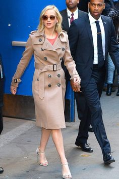 Jennifer Lawrence wearing Oliver Peoples Masek Sunglasses, Burberry High Waist Cashmere Coat in Pale Taupe Melange and Casadei Dove Grey Suede Ankle-Strap Sandals