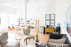 Inside The Man Repeller's New Office - Leandra Medine New Office Interior Design - Elle. Featuring Blu Dot Hitch Bookcase, Real Good Copper Chairs, White Strut Table, Grotto Sofa and Scamp Coffee Table.