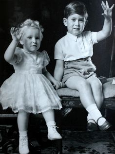 Hidden Royal portraits revealed:The set includes family snapshots such as this image of the three-year-old Prince of Wales placing a protective arm around his sister, the Princess Royal, who was then 20 months old