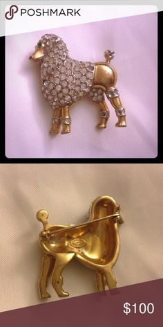 💕❤️💕Kramer of New York figural poodle brooch Rare and collectible vintage jewelry.  Stunning goldtone brooch with clear rhinestones and green crystal eyes.  Some stones missing but can be replaced.  😍💯 Kramer of New York Jewelry Brooches