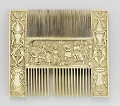 A NORTHERN FRENCH, EARLY 16TH CENTURY IVORY COMB WITH THE STORY OF TRAJAN ; (ONE TOOTH MISSING) WITH COLLECTION LABEL