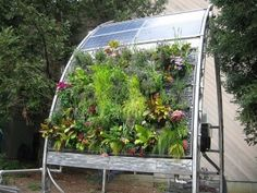 Holy Tomatoes!  A vertical, solar powered, self-watering garden... that looks awesome. I do believe I've been inspired.
