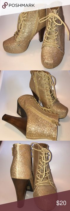 GOLD PLATFORM BOOTIES Approx 4 inch heel. Shoelace detail with inner side zippers. Only worn once! Perfect statement piece to glamorize any plain outfit. The chunky heel makes them extremely comfortable to walk in. Charlotte Russe Shoes Ankle Boots & Booties
