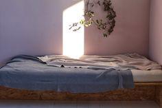 Simple, minimal bed + sunlight spot