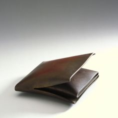 """""""Cushion object, two parts"""" by Françoise van den Bosch, 1974. Patinated brass."""
