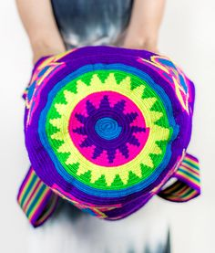 """Mochila Wayuu bags are a fresh and colorful take on the traditional shoulder bag. Crocheted with exquisite craftsmanship by a remote group of indigenous women living in northern Colombia, each bag is uniquely designed based on a centuries-old stitching technique and incorporates a hand-braided strap and surprisingly roomy pouch. Throw the true definition of """"contemporary tradition"""" over your shoulder this spring! Tapestry Bag, Tapestry Crochet, Crochet Pillow, Crochet Handbags, Hand Stitching, Pouch, Shoulder Bag, Traditional, Tote Bag"""