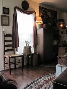 Love the ladderback chair and braided rug! Along with everything else in the room. Ha
