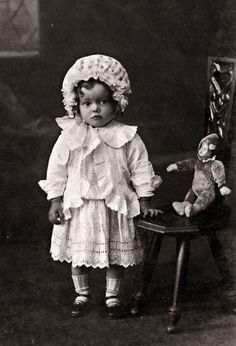 antique photo of little girl with her teddy/baby - mohair jointed doll with bisque or composition face.