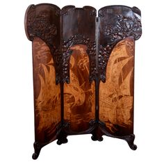 Italian folding screen in Liberty Style; the Italian Art Nouveau, by the Florence furniture maker firm of Girard and Cuttler. The piece is in walnut, mahogany and satinwood; ca. 1900.