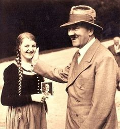 """""""Herr"""" Hitler savouring a young girl."""