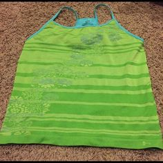 Hind tank top Super cute bright green and turquoise workout tank. Has a built in bra and is very supportive. Size large but runs small. Cute flower design with stripes on front and back. Hind Tops Tank Tops