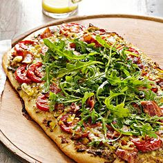 Pesto-Bacon-Tomato Pizza with Arugula Salad Topper From Better Homes and Gardens, ideas and improvement projects for your home and garden plus recipes and entertaining ideas.
