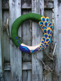 Peacock Wreath. Would never be caught dead with it on my door but it is AWESOME!