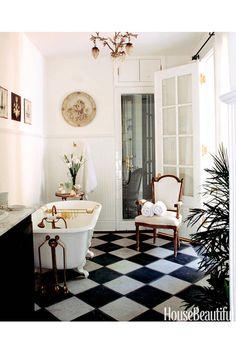 Bathroom claw bath black and white tiles white walls