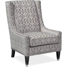 Captivating Intricacy. Complete a cozy reading nook with the mesmerizing Venn accent chair. Wrapped in supremely soft upholstery with a chic rhythmic pattern, this accent chair will complete your home décor. Lustrous nailhead trim adorns the silhouette, while a subtle wingback design adds traditional flair.
