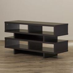 Amplify the beauty of your living room by decorating it with this modern-styled TV Stand. It successfully gives your place an elegant and organized look. #freeshipping