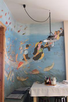 Wandmalerei in einem Fischrestaurant.