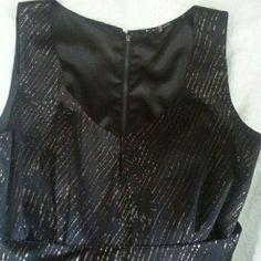 Tahari black w gold streaks dress Black dress w fabric belt form fitting very well made. Elie Tahari Dresses Midi