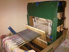 WOW! Instructions on how to build a loom with cardboard and bamboo skewers--a 4-harness loom shown but could be made with up to 8 harnesses! LOVE the ingenuity!