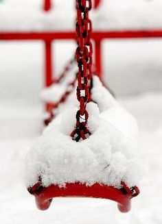 snow on a swing. now that it's springtime I can appreciate the beauty of this picture.