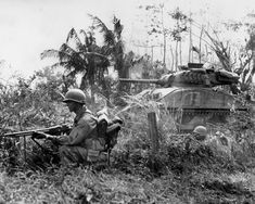 37th_Infantry_Division_BAR_Gunner_and_M4_Sherman_on_Luzon_1945 148/37-ID, Operations at Manila, Luzon, Philippine Islands, 1945
