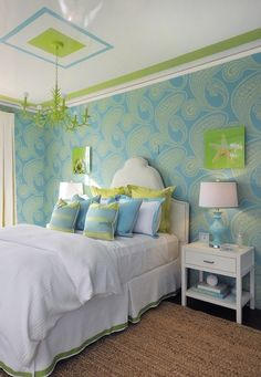 Fresh, modern turquoise blue and green teen girl's bedroom design featuring Cole Son Rajapur Wallpaper. A Ballard Designs 5-light Coral Chandelier painted in lime green hangs above the bed and is bordered with a turquoise square and green stripe running around the perimeter of the ceiling.
