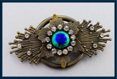 Art Nouveau peacock glass and brass brooch