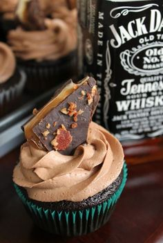 Chocolate-Whiskey Cupcakes topped with marshmallow, caramel, chocolate, whiskey, bacon bark. This has Dan's birthday written all over it.