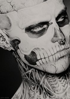 Zombie Boy.  BTW, this is NOT makeup.  The majority of his body is tattooed.  He promotes L'Oreal's Dermablend cosmetics line for its ability to cover tattoos.