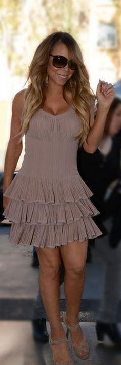Who made  Mariah Careys nude ankle sandals and pink ruffle dress?