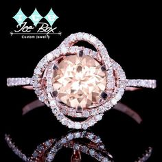 Morganite Engagement Ring. This gorgeous ring features an 1ct, 6.5mm round pale peachy pink morganite set in a 14K rose gold diamond setting. Ring Information: